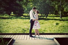 Young couple in love standing on wooden cross-roads Royalty Free Stock Image