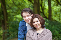 Young couple in love in forest Royalty Free Stock Photography