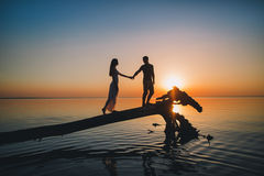 Young couple in love at sunset Stock Photography