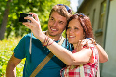 Young couple in love take picture themselves. Young couple in love take picture of themselves outdoor Stock Photos