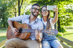 Young couple in love takes a selfie Stock Photography
