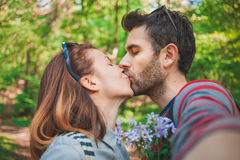 Young couple in love taking a selfie while kissing stock image