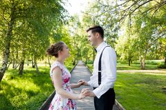 Young couple in love together, holding hands. Royalty Free Stock Photos