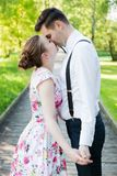 Young couple in love together, holding hands. Stock Photos