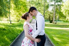 Young couple in love together, holding hands. Royalty Free Stock Image