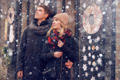 Young couple in love couple travels on St. Valentine`s Day. Holidays in Europe. Warm clothes, hat. scarf, nice atmosphere. Winter, Stock Images