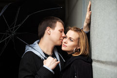 Young couple in love with umbrella Royalty Free Stock Photos