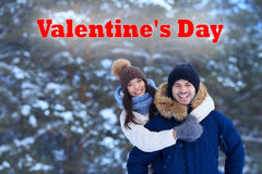 Young couple in love on Valentines Day. Romantic walking in winter woods Royalty Free Stock Photography