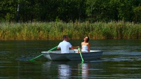 Young couple love walk in boat on lake stock footage