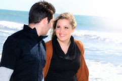 Young couple in love walking along the seashore Royalty Free Stock Photo