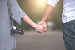 Young couple in love walking in the autumn park holding hands Royalty Free Stock Image