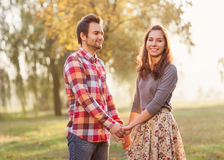 Young couple in love walking in the autumn park Royalty Free Stock Photos