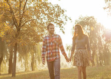 Young couple in love walking in the autumn park Stock Photo