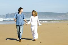 Young couple in love walking at the beach Royalty Free Stock Photos