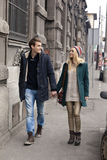 Young couple in love walking in the city Stock Images