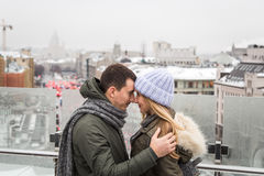 Young couple in love walking in the city, holding hands Stock Photo