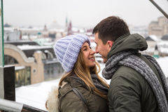 Young couple in love walking in the city, holding hands Royalty Free Stock Photo