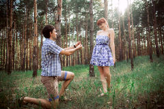 A young couple in love walking in the woods royalty free stock image