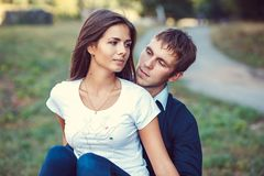 Young couple in love walks in nature Stock Photos