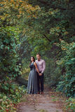 Young couple in love walks in nature. On a sunny day Royalty Free Stock Photo