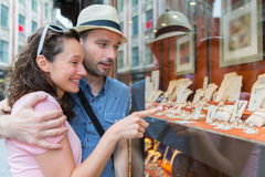 Young couple in love watching jewelry store front. View of a Young couple in love watching jewelry store front stock image