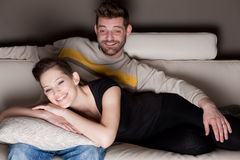 A young couple in love watching something funny Royalty Free Stock Image
