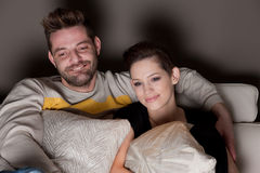 A young couple in love watching TV Stock Photography