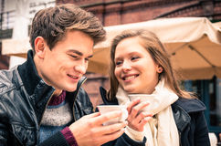 Young Couple lovely enjoying a cup of Coffee stock image