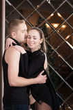 Young couple, lovers embracing in studio. Relationship Stock Photo