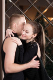 Young couple, lovers embracing in studio. Relationship Stock Image