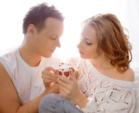 Young couple of lovers. Man presents flower Stock Image