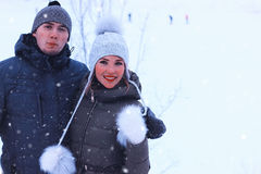 Young couple of lovers walk in winter park Stock Photo