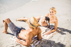 Young couple lying on beach. Happy young couple lying on beach Royalty Free Stock Photography