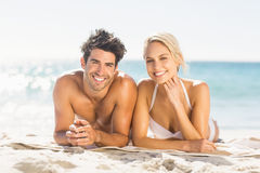 Young couple lying on beach Stock Images