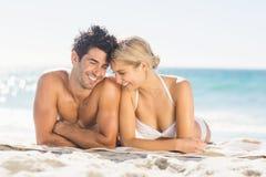 Young couple lying on beach. Romantic young couple lying on beach Stock Photo
