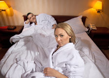 Young couple lying on the bed Stock Photo