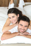 Young couple lying in bed Royalty Free Stock Images