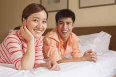 Young Couple Lying on Bed Royalty Free Stock Photos