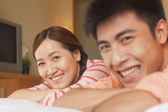 Young Couple Lying on Bed Royalty Free Stock Image