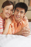 Young Couple Lying on Bed Royalty Free Stock Images