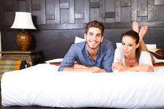 A young couple lying on the bed in an asian style hotel room Stock Photos