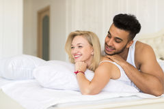 Young Couple Lying In Bed, Happy Smile Hispanic Man And Woman. Lovers In Bedroom Royalty Free Stock Images