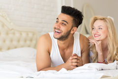 Young Couple Lying In Bed, Happy Smile Hispanic Man And Woman Lovers In Bedroom Stock Images