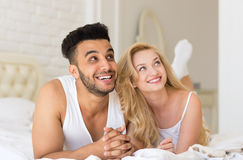 Young Couple Lying In Bed, Happy Smile Hispanic Man And Woman Lovers In Bedroom Royalty Free Stock Image