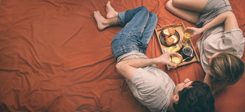 Young couple is lying in bed . Stock Image