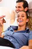 Young couple lying on bed in hotel room Stock Image