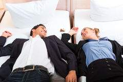 Young couple lying on bed in hotel room Stock Photo