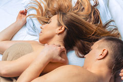 Young couple lying in bed. Stock Image