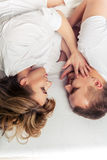 Young couple lying in bed. Royalty Free Stock Photo
