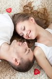 Young couple lying on the carpet Stock Image